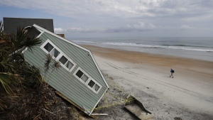 A house rests on the beach after collapsing off a cliff from Hurricane Irma in Vilano Beach, Fla., Friday, Sept. 15, 2017. (AP Photo/David Goldman)