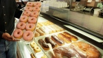 In this April 26, 2011 file photo, doughnuts are displayed in Chicago. (M. Spencer Green / AP)