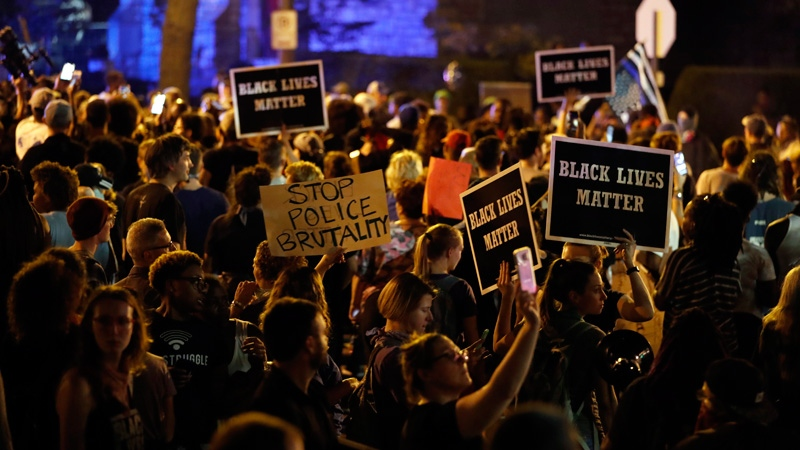 Protesters gather, Friday, Sept. 15, 2017, in St. Louis, after a judge found a white former St. Louis police officer, Jason Stockley, not guilty of first-degree murder in the death of a black man, Anthony Lamar Smith, who was fatally shot following a high-speed chase in 2011. (AP /Jeff Roberson)