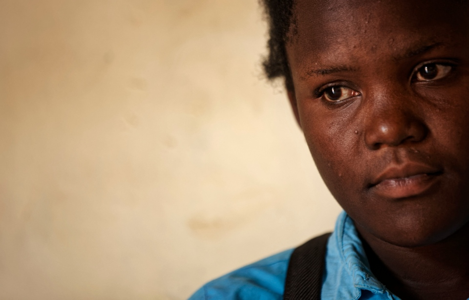 In this Wednesday, May 31, 2017 photo, Asimart Nakabanda, 15, whose child marriage was foiled at the planned wedding ceremony in a surprise raid by police, discusses the events in the village of Lwamaggwa, near Masaka, in Uganda. She now wants to go back to school to study. (AP Photo/Ben Curtis)