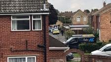 Police raid a property, in Sunbury, London.