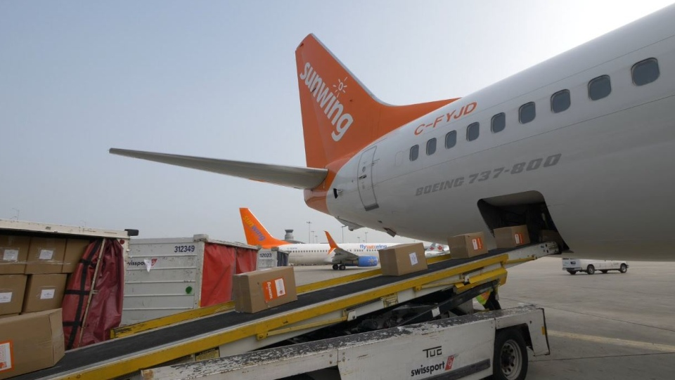A Sunwing flight is loaded with humanitarian aid headed to Antigua and Barbuda, in Toronto, on Friday, Sept. 15, 2017.