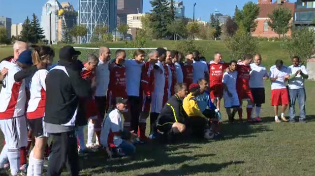 CPS members and Drop-In Centre residents gather for a group photo ahead of Saturday morning's friendly soccer match in McDougall Park