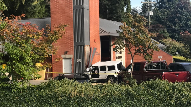 The building has been evacuated while crews wait for a structural engineer to assess whether it's safe to remove the vehicle. (CTV)