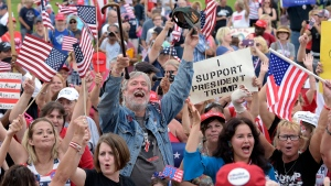 People gather on the National Mall in Washington, Saturday, Sept. 16, 2017, to attend a rally in support of U.S. President Donald Trump in what organizers are calling 'The Mother of All Rallies.' (AP Photo / Susan Walsh)