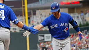 Toronto Blue Jays' Josh Donaldson, right, is congratulated by Justin Smomak following his solo home run off Minnesota Twins pitcher Adalberto Mejia in the first inning of a baseball game Saturday, Sept. 16, 2017, in Minneapolis. (AP Photo / Jim Mone)
