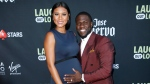 In this Aug. 3, 2017, file photo, comedian Kevin Hart and his wife Eniko Parrish pose at Kevin Hart's 'Laugh Out Loud' new streaming video network launch event at the Goldstein Residence on in Beverly Hills, Calif. (Danny Moloshok / Invision / AP)