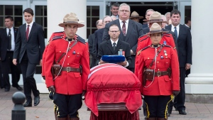 Prime Minister Justin Trudeau, left, follows Allan MacEachen's coffin at a celebration of his life in Antigonish, N.S. on Sunday, Sept. 17, 2017. MacEachen, the longtime Nova Scotia MP, cabinet minister, senator and Canada's first deputy prime minister, died earlier in the week at age 96. (THE CANADIAN PRESS/Andrew Vaughan)
