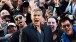 "Director and Actor George Clooney poses for photograph with fans on the red carpet for the movie ""Suburbicon"" during the 2017 Toronto International Film Festival in Toronto on Saturday, September 8, 2017. THE CANADIAN PRESS/Nathan Denette"
