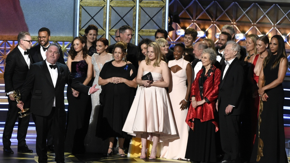 Bruce Miller and the cast and crew accept the award for outstanding drama series for 'The Handmaid's Tale' at the 69th Primetime Emmy Awards at the Microsoft Theater in Los Angeles on Sunday, Sept. 17, 2017. (Chris Pizzello / Invision)