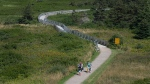 Visitors walk on the boardwalk on the Greenwich peninsula portion of Prince Edward Island National Park in Greenwich, Prince Edward Island on Tuesday, Aug. 29, 2017. The site contains an extensive and fragile coastal dune system, wetlands and various natural habitats in which numerous rare plant species are found. (THE CANADIAN PRESS/Andrew Vaughan)