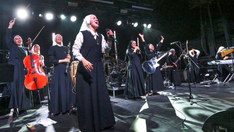 In this Friday, Sept. 8, 2017, photo provided by Diocese of Orange, 'Siervas,' a nun rock band performs live at the Festival de Cristo at Christ Cathedral in Garden Grove, Calif. (Challenge Roddie/Diocese of Orange via AP)