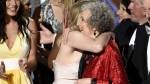 Elisabeth Moss, left, embraces Margaret Atwood at the 69th Primetime Emmy Awards on Sept. 17, 2017. (Chris Pizzello / Invision / AP)