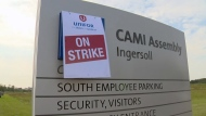 A Unifor sign covers the General Motors logo during a strike at the CAMI assembly plant in Ingersoll on Monday, Sept. 18, 2017.