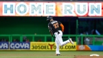 In this Sept. 2, 2017, file photo, Miami Marlins' Giancarlo Stanton rounds second base after hitting a home run during the first inning of a baseball game against the Philadelphia Phillies, in Miami. (Wilfredo Lee/AP Photo)
