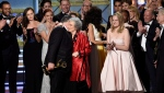 "Bruce Miller, from left, Margaret Atwood, and Elisabeth Moss accept the award for outstanding drama series for ""The Handmaid's Tale"" at the 69th Primetime Emmy Awards in Los Angeles on Sunday, Sept. 17, 2017. (THE CANADIAN PRESS/AP-Invision, Chris Pizzello)"