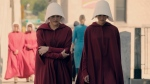 Cast members from 'The Handmaid's Tale' walk on the Main Street bridge in Cambridge during filming. (City of Cambridge)