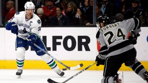 In this Saturday, March 4, 2017, file photo, Vancouver Canucks center Henrik Sedin, left, of Sweden, passes the puck against Los Angeles Kings defenseman Derek Forbort during the first period of an NHL hockey game in Los Angeles. (Alex Gallardo/AP Photo)