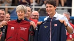 Prime Minister Justin Trudeau and British Prime Minister Theresa May hold Invictus national team jackets after receiving them at an event promoting the upcoming Toronto Invictus games, during a visit in Ottawa on Monday, Sept. 18, 2017. THE CANADIAN PRESS/Justin Tang