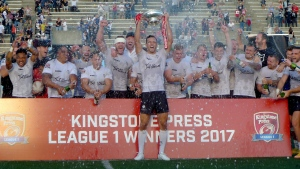 Toronto Wolfpack captain Craig Hall hoists the trophy as the first-year rugby league team celebrates winning the Kingstone Press League 1 title and promotion to the English second-tier after defeating the Barrow Raiders 26-2 at Toronto's Lamport Stadium, Saturday, September 9, 2017. (Neil Davidson/The Canadian Press)