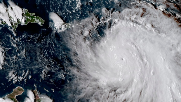 This Monday, Sept. 18, 2017, GOES East satellite image provided by NASA taken at 4:30 p.m. ET, shows the eye of Hurricane Maria as it nears Dominica. (NASA via AP)
