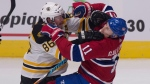 Montreal Canadiens forward Brendan Gallagher, right, and Boston Bruins defenceman Kevan Miller fight during third period action of an NHL preseason game Monday, September 18, 2017 at the Videotron Centre in Quebec City. THE CANADIAN PRESS/Jacques Boissinot