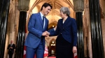 Prime Minister Justin Trudeau shakes hands with British Prime Minister Theresa May as she leaves Parliament Hill in Ottawa on Monday, Sept. 18, 2017. THE CANADIAN PRESS/Justin Tang