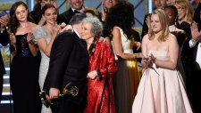"Bruce Miller, from left, Margaret Atwood, and Elisabeth Moss accept the award for outstanding drama series for ""The Handmaid's Tale"" at the 69th Primetime Emmy Awards in Los Angeles on Sunday, Sept. 17, 2017. The Canadian literary community is celebrating the success of the series ""The Handmaid's Tale,"" which is based on Toronto author Margaret Atwood's 1985 dystopian novel. THE CANADIAN PRESS/AP-Invision, Chris Pizzello"