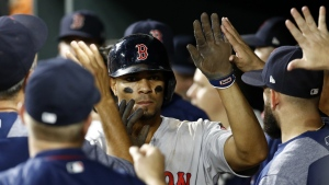 Boston Red Sox's Xander Bogaerts high-fives teammates in the dugout after scoring on Andrew Benintendi's single in the 11th inning of a baseball game against the Baltimore Orioles in Baltimore on Monday, Sept. 18, 2017. (AP / Patrick Semansky)