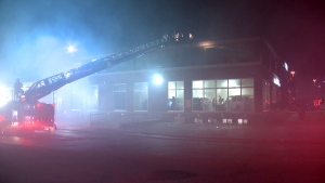 Firefighters rushed to Prime Leasing in TMR after it was attacked by an arsonist for the third time in a month (CTV Montreal/Cosmo Santamaria)