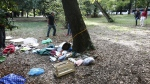 A photographer takes pictues of a homeless' belongings near the area where a woman was allegedly raped in Rome's Villa Borghese park, Monday, Sept. 18, 2017. (Massimo Percossi/ANSA via AP)