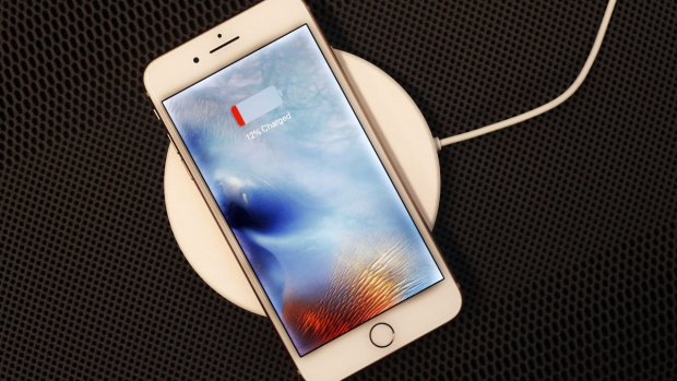 iPhone 8 Plus rests on a wireless charger in New York, on Sept. 15, 2017. (Mark Lennihan / AP)