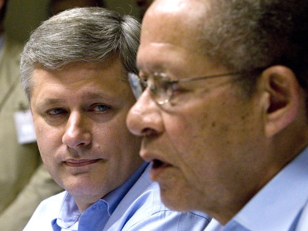 Prime Minister Stephen Harper listens as Jamaican Prime Minister Bruce Golding speaks during a news conference in Montego Bay, Jamaica, on Monday April 20, 2009. (Adrian Wyld / THE CANADIAN PRESS)