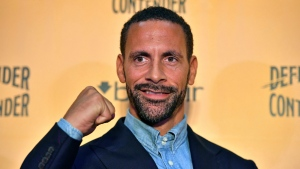 Ex-footballer Rio Ferdinand poses for the media during a press conference at York Hall, London, Tuesday, Sept. 19, 2017. (Dominic Lipinski/PA via AP)