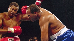 In this March 15, 1985, file photo, Larry Holmes, left, battles David Bey during a bout in Las Vegas. (AP Photo/File)