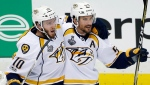 Nashville Predators' Colton Sissons, left, celebrates his goal against the Pittsburgh Penguins with Roman Josi during the third period in Game 1 of the NHL hockey Stanley Cup Finals, May 29, 2017, in Pittsburgh. (Gene J. Puskar/AP)