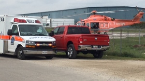 A man was airlifted to hospital after a bus fell on him at a business in Fergus on Tuesday, Sept. 19, 2017. (David Pettitt / CTV Kitchener)
