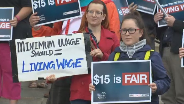 Dozens rally at legislature to call for $15 minimum wage