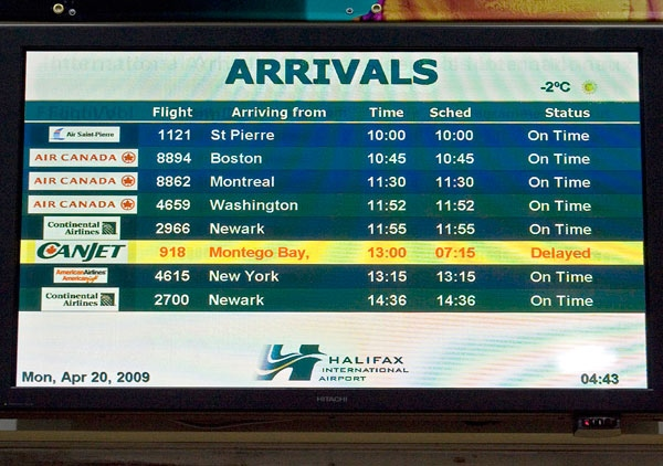 The arrivals board at the airport in Halifax shows the anticipated arrival of CanJet Flight 918 from Jamaica on Monday, April 20, 2009. (Andrew Vaughan / THE CANADIAN PRESS)