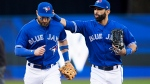 Toronto Blue Jays centre fielder Kevin Pillar, left, is congratulated by teammate Jose Bautista after making an inning-ending catch in fifth inning American League MLB baseball action against the Detroit Tigers in Toronto on Saturday, September 9, 2017. (THE CANADIAN PRESS/Aaron Lynett)