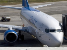 A ground transport vehicle passes by the CanJet plane which was hijacked in Montego Bay, Jamaica, Monday April 20, 2009. (Adrian Wyld / THE CANADIAN PRESS)