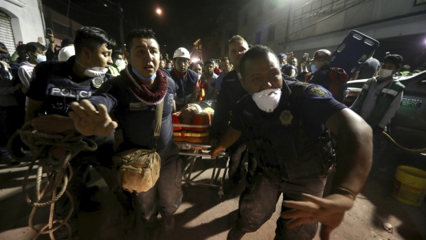 An injured person is carried after being rescued from the rubble of a building that collapsed after an earthquake, in the Colonia Obrera neighbourhood of Mexico City on Tuesday, Sept. 19, 2017. (AP / Miguel Tovar)