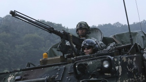 U.S. Army soldiers from the 2nd Infantry Division's the 2nd Armored Brigade Combat Team ride an armoured vehicle during a joint military exercise between the U.S. and South Korea at the Rodriquez Multi-Purpose Range Complex in Pocheon, South Korea on Tuesday, Sept. 19, 2017. (AP / Ahn Young-joon)