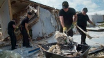 The crew of HMCS St. John's continues clean-up operations at a school on South Caicos Island during Operation RENAISSANCE, the Hurricane Irma humanitarian aid mission, in the Caribbean on September 17, 2017. The crew of HMCS St. John's is helping deliver supplies and clear debris in the Caribbean in the wake of hurricane Irma. (THE CANADIAN PRESS/HO-Formation Imaging Services Halifax-MCpl Chris Ringius)