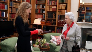 Canadian Governor General Designate Julie Payette, left, meets Queen Elizabeth II during a private audience at Balmoral Castle, Scotland, Wednesday Sept. 20, 2017. (AP / Andrew Milligan)