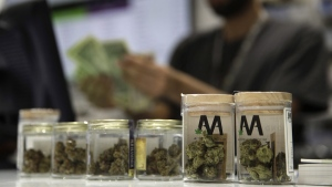 A cashier rings up a marijuana sale at the Essence cannabis dispensary in Las Vegas on July 1, 2017. (John Locher / AP)
