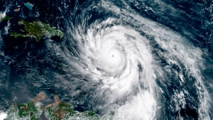 This, GOES-16 satellite image taken Tuesday, Sept. 19, 2017, at 14:45 UTC and provided by National Oceanic and Atmospheric Administration (NOAA), shows Hurricane Maria southeast of Puerto Rico. (NOAA via AP)