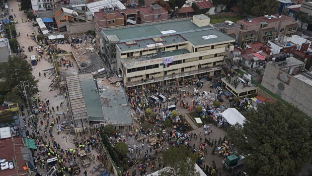 Volunteers and rescue workers search for children trapped inside the Enrique Rebsamen school in southern Mexico City, on Sept. 20, 2017. (Miguel Tovar / AP)