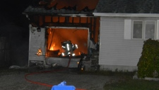 Fire destroys a garage in Victoria Harbour, Ont. on Tuesday, Sept. 19, 2017.