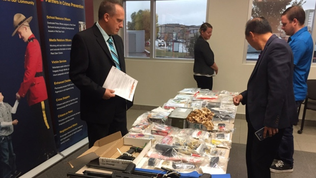 Red Deer RCMP display some items seized from four homes and two cars in Sylvan Lake on September 12, 2017.
